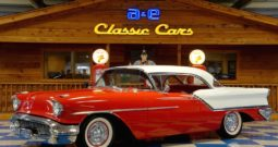 1957 Oldsmobile Deluxe 88 – Red / White